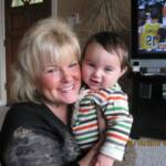Micki Reich brost with her 10th grandchild, Miles