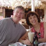 Keith and Dolores Anderson sipping Pina Colada's in Belize